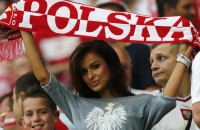 Fan of Poland holds up a team scarf before the start of their Group A Euro 2012 soccer match against Czech Republic at the City Stadium in Wroclaw,