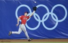 Canada's right fielder Michael Saunders (20) fields a first inning fly out by Cuba's Yuliesky Gurriel during a baseball game at the Beijing 2008 Olympics in Beijing, Thursday, Aug. 14 2008. (AP Photo/Kathy Willens)